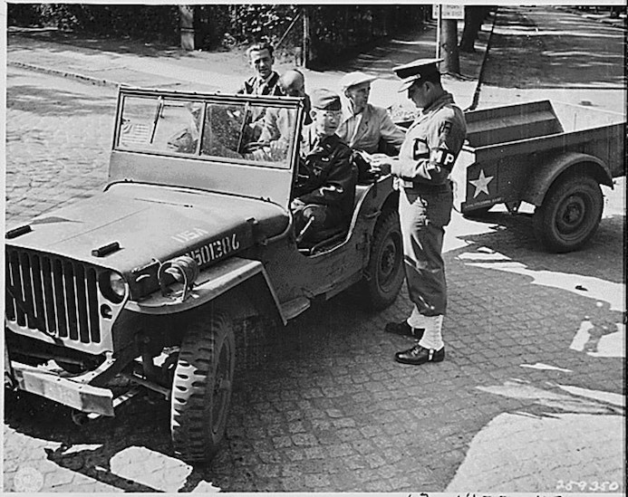 A US Army Jeep towing an American Bantam Trailer